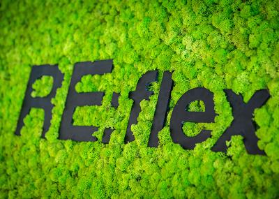 Moss wall with the RE:flex logo